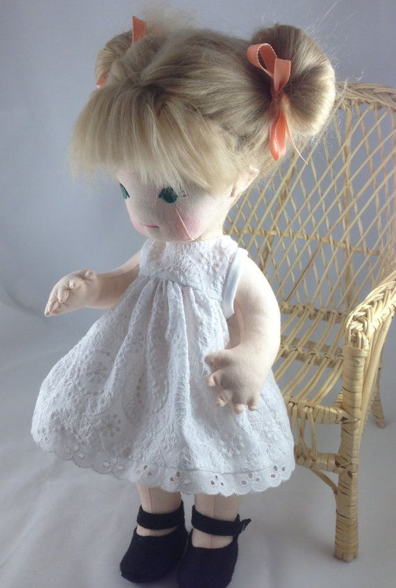 Vintage Inspired Button Jointed Cloth Doll by mybonbonboutique  Her hair is made of ash blonde Tibetan lamb's wool. Although shown in pigtails, it can be brushed and styled into many hairstyles.