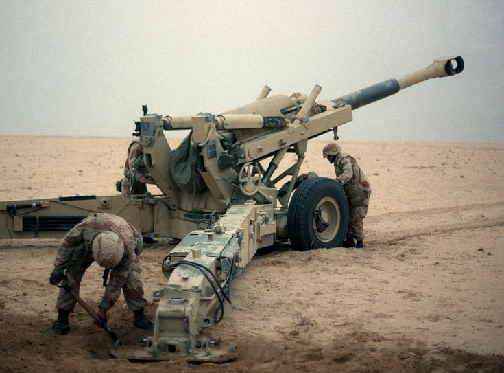 Artillerymen of the US Marine Corps reloading an M198 howitzer during Operation Desert Storm.