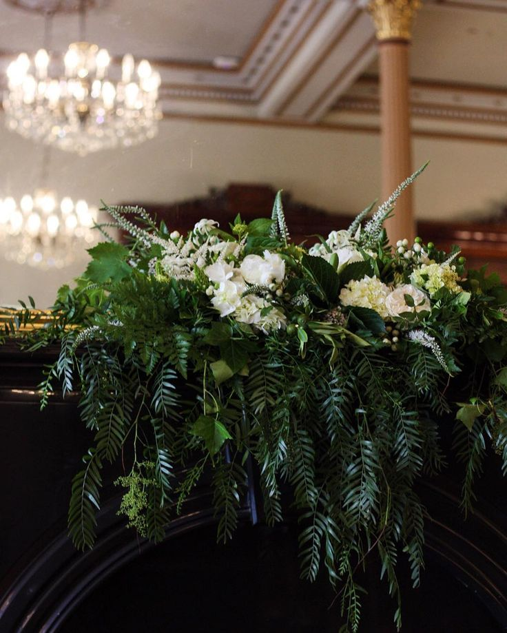 • Ditto Ditto weddings •   A moment of mantlepiece grandeur at one of this weekend's weddings. We loved the drape in this floral mantlepiece arrangement.