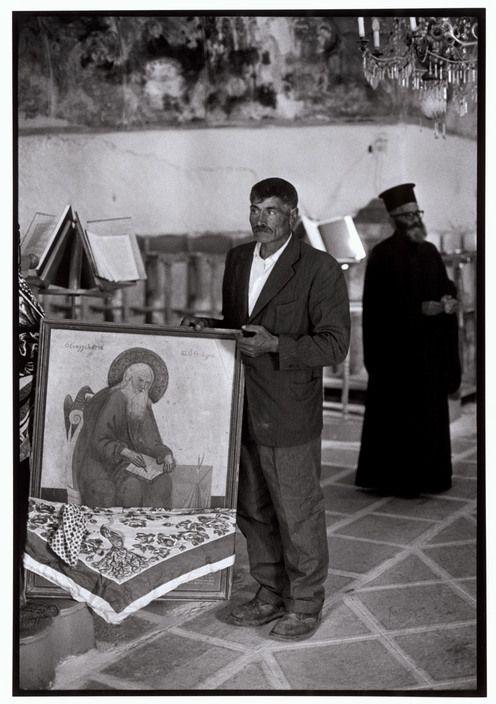 "Constantine Manos View profile GREECE. Karpathos. Olympos 1964. Blessing the icons. ""A Greek Portfolio"" p.33 © Costa Manos/Magnum Photos"