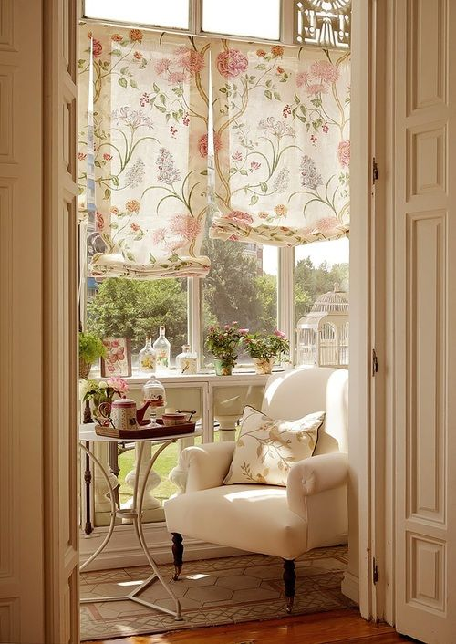 Someone has found a sunny, attractive little nook for tea, reading, and daydreaming! Lightness abounds in this tiny space!