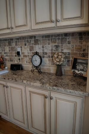 Cabinets refinished to a custom off white finish with heavy glaze by Maureen Tinnes