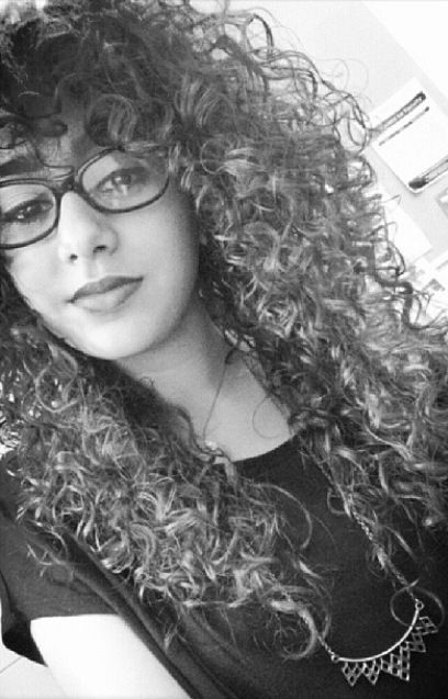 Natural curly hair. I wonder if my hair would look good with curly bangs?