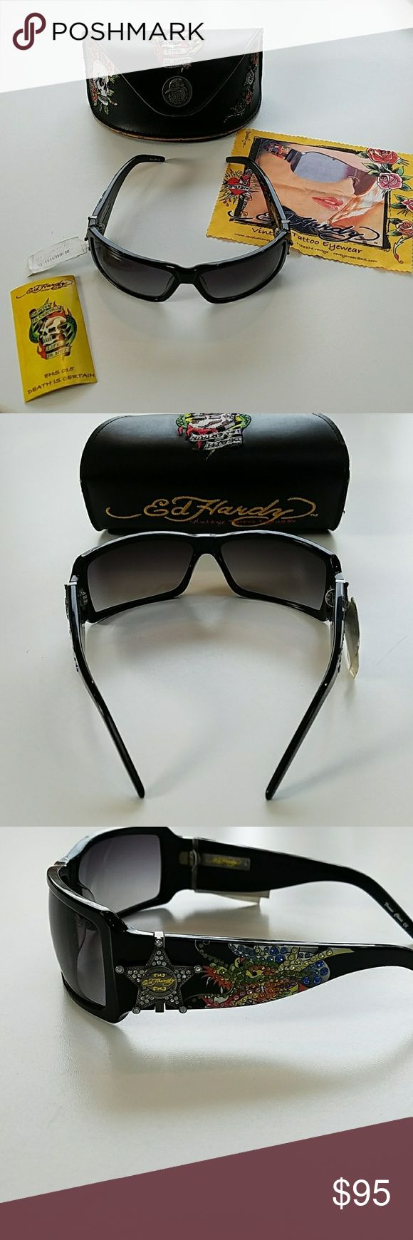 Ed Hardy Tattoo Eyewear Sunglasses Ed Hardy Tattoo Eyewear Sunglasses. Nwt! In perfect new condition. Includes beautiful Ed Hardy sunglass case, extra Swarovski Crystals and glass cleaner cloth. Ed Hardy Accessories Glasses
