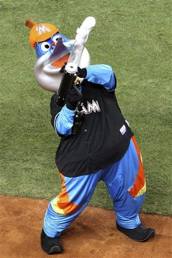 Miami Marlins mascot Billy the Marlin shoots shirts into the crowd during a spring training baseball game against the New York Yankees, Monday, April 2, 2012, in Miami.