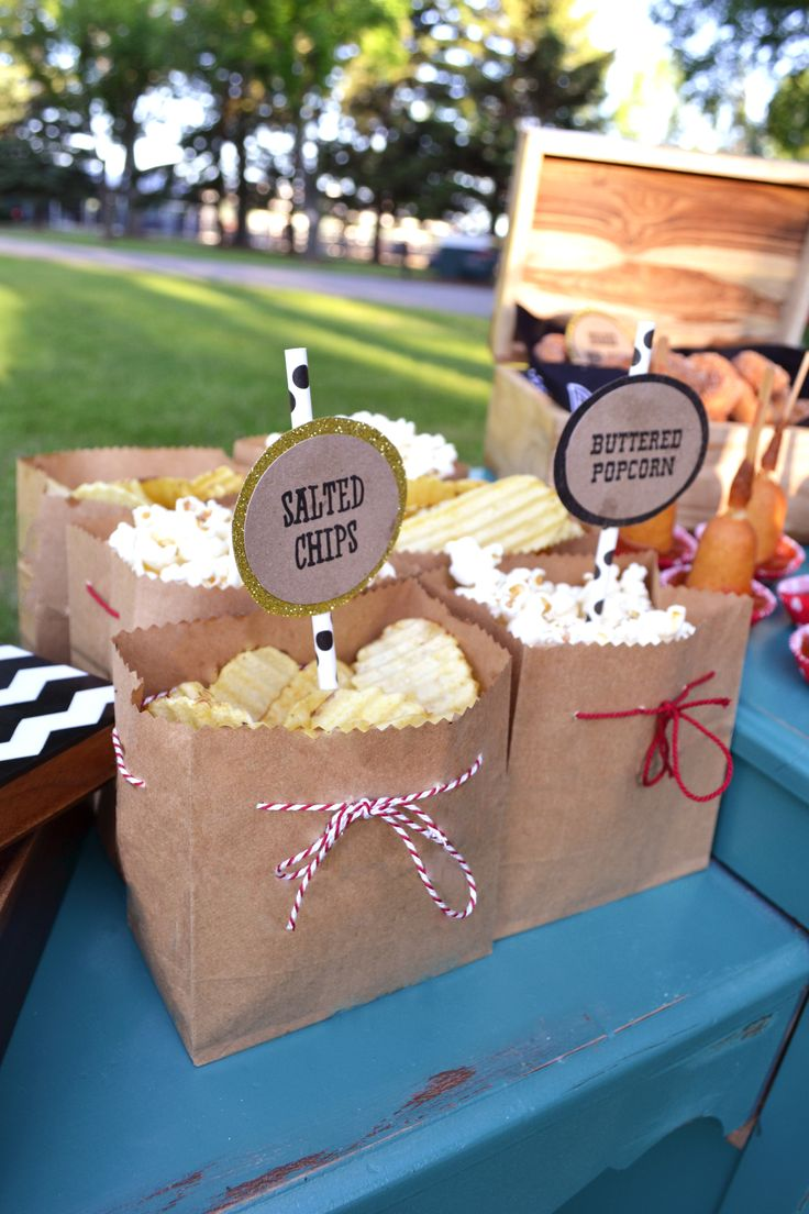 I like the popcorn in the cutoff paper bags. cute! or could use mini paper bags….Inelia