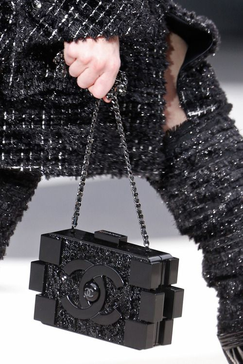 Chanel handbag from Fall 2013. Look at the boucle thigh high boots too!