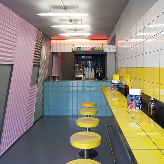 The constraints of the premises were of prime consideration to London design studio Brinkworth — Voodoo Ray's consists of three shipping containers — who played on the linear geometry of the space with three bar counters backed with bold tiling that echoes the Dalston forerunner...
