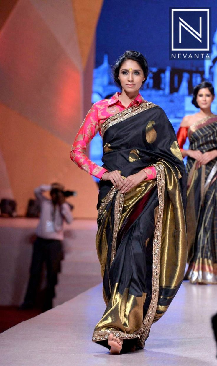A wonderful combination of black #banarasi saree with a full-sleeve #pink blouse