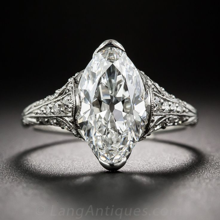 Ring an icy white full figured old european cut marquise diamond