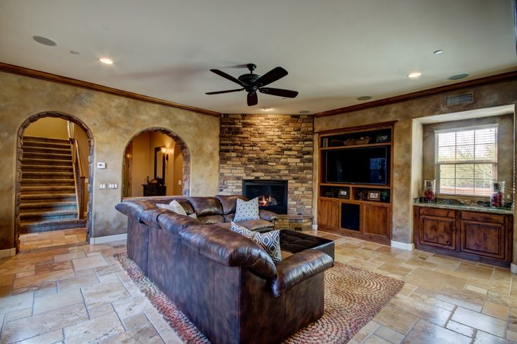 Living room, fireplace, spacious, tile, media station, stone