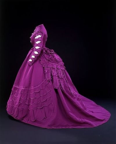 Paris, France 1869-1870 Vignon Dress made with two different bodices, skirt, peplum and bow made of magenta-coloured ribbed silk trimmed with satin.