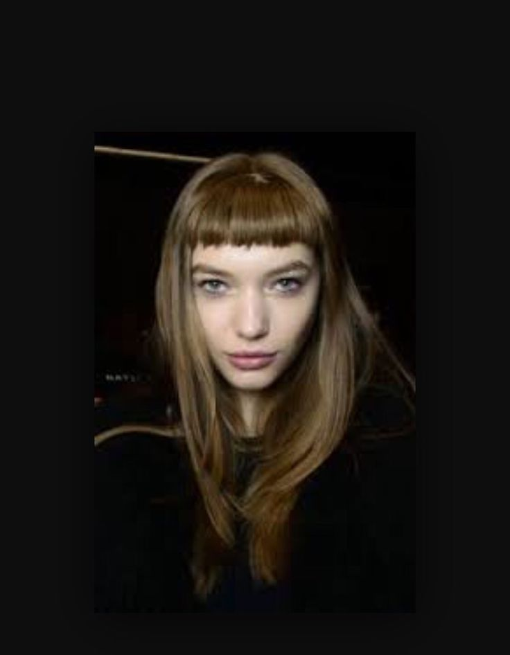 Very French: long hair, cute and innocent short bangs, in a very light unassuming brown  shade.