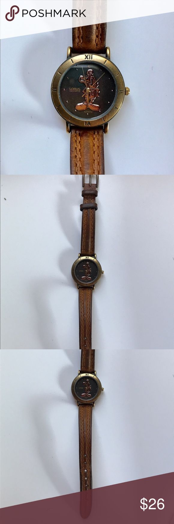 Vintage Mickey mouse watch Bronze and gold tone watch with narrow brown leather strap. Pre loved for many years. Leather shows aging but no weakening or wear. Strap can be replaced. New battery. Lorus Jewelry