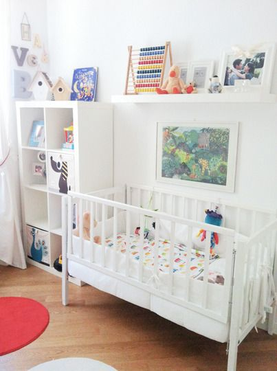 I love how they arranged this nursery so the bed almost seems to be in an alcove.  The bookcase and upper shelf is where it's at.