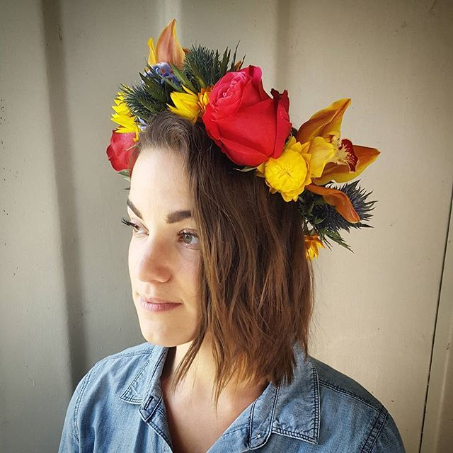 Our statement flower crown in vibrant pinks and yellow with touches of blue.