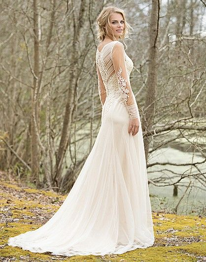 Softly draped tulle and lace trim combine to create this dreamy long sleeve gown. A V-neck, illusion long sleeves and back, cotton lace appliqués, and finished hem lace are completed by a sweep train.