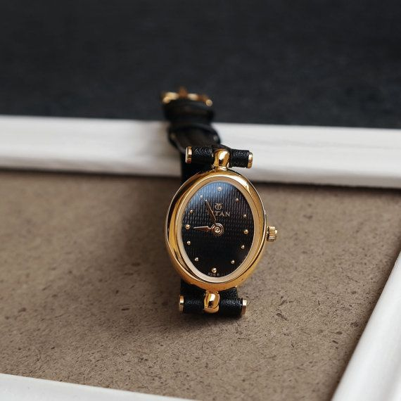 Titan Posh in Black | Vintage petite women's minimalist style watch in gold oval t-bar bezel, black textured face, small leather strap