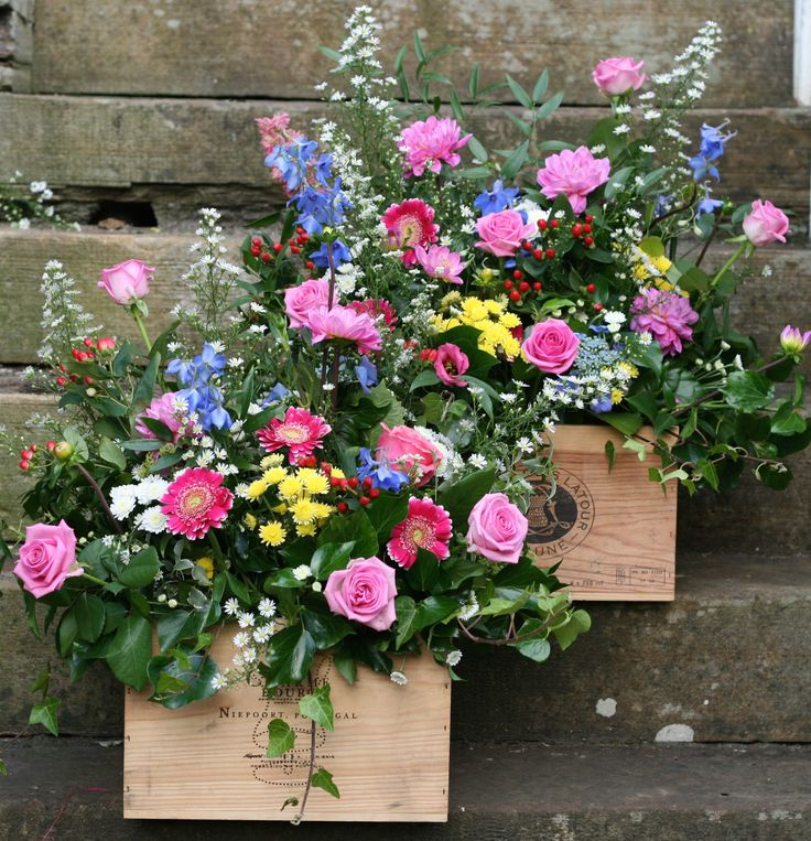 A couple of rustic wooden wine crates full of beautiful bright blooms for a July wedding at Wedderburn Castle. Contact The Stockbridge Flower Company, Edinburgh for more details