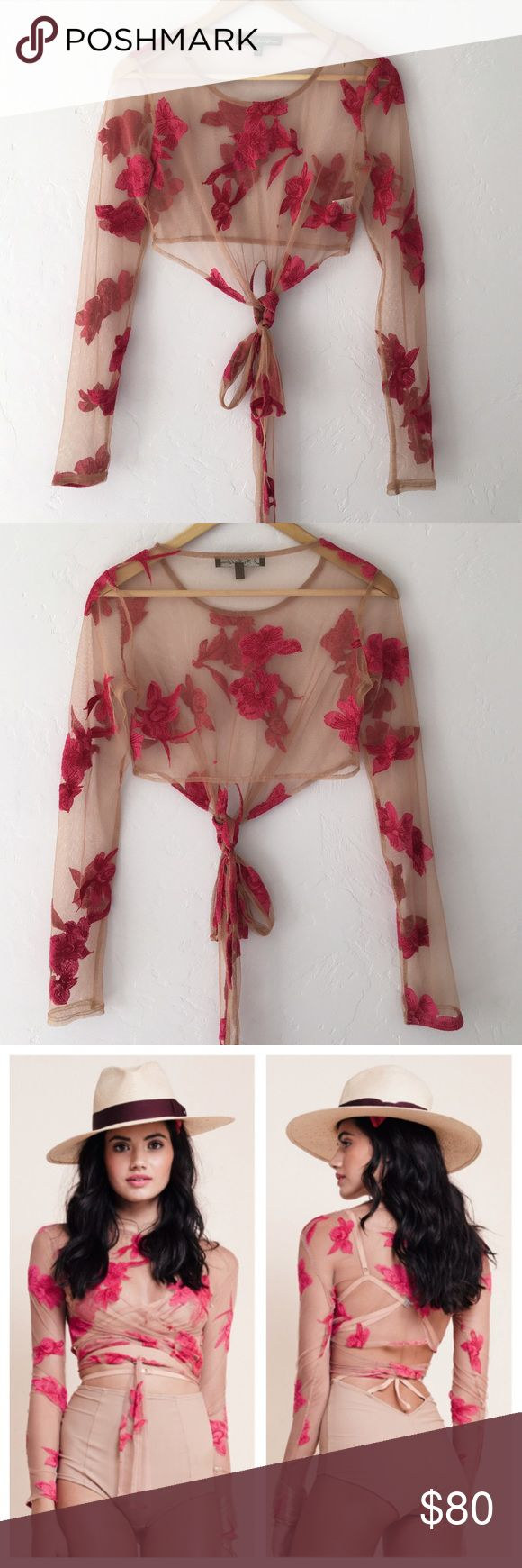 """For Love & Lemons Orchid Crop Top For Love and Lemons nude mesh crop top in """"Paradise Pink."""" Features tulle, orchid embroidery and a wrap around front tie. Perfect condition except for a teeny tiny hole in the left armpit (see picture #4.) Sold out online. For Love and Lemons Tops Crop Tops"""
