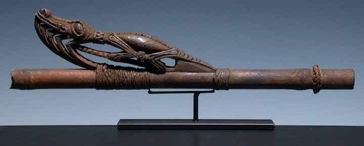 "Spear thrower (middle section). Vokeo Island. The hardwood carved zoomorphic figure is of extremely high quality-it is very unusual to see the four limbs from the animal carved free from the body. L. 17"".  Michael Hamson Oceanic Art"