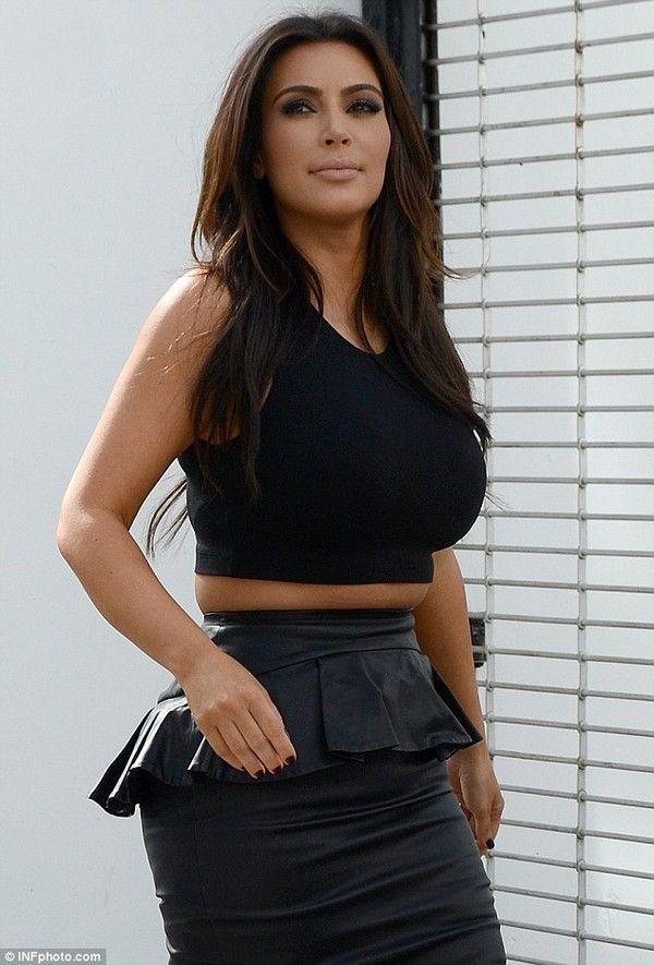 Kim and Kourtney Kardashian Wear Matching Peplum Skirts in Miami