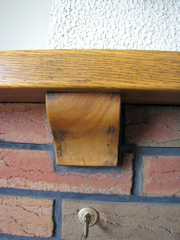 Oak mantel, need to refer to this colour tone with kitchen choices (fine with different wood species)