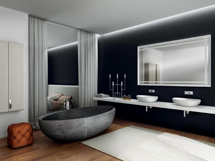 http://www.drissimm.com/wp-content/uploads/2015/04/Stylish-modern-bathroom-with-large-mirror-on-black-wall-and-double-white-sinks-also-oval-stone-bathtub.jpg