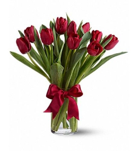 Beautiful and 'simply said ' red tulips are a hip way to show you care.Twenty romantic red Tulips arranged in a clear glass vase.