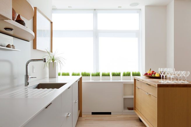In a West Village renovation, designer Suchi Reddy crafted a kitchen that would keep the windows unobstructed. The cabinets and rolling island are by Henrybuilt. Photo by Ball & Albanese.  Photo by: Ball & Albanese