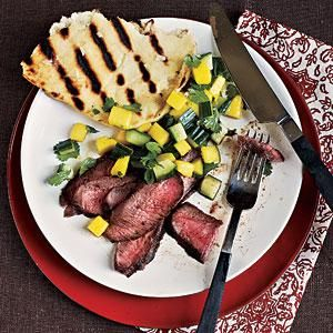 The flavor of the fresh, fruity salsa pairs perfectly with the grilled steak. Round the meal out with garlic flatbread for a summer-ready dinner. Serves 4