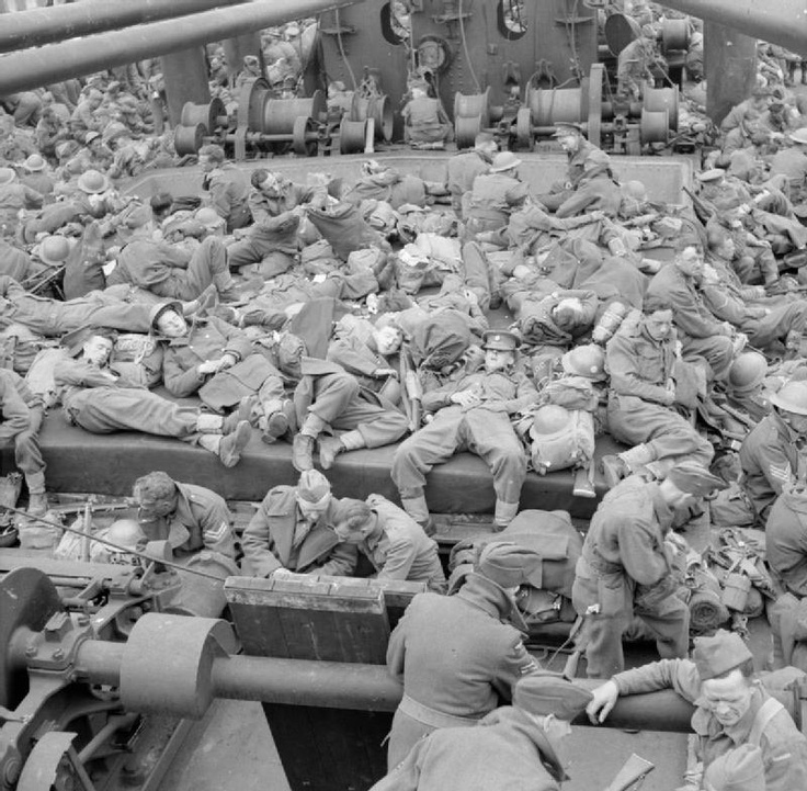 THE BRITISH ARMY IN FRANCE 1940. Exhausted troops rest aboard the troopship 'Guinean' at Brest during the evacuation of British forces from France, June 1940.