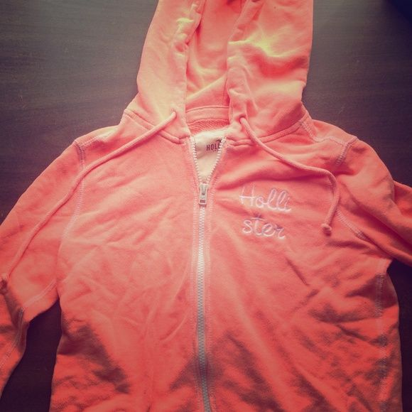 Hollister bright jacket Cute Hollister zip up jacket. Worn a few times, in great condition. A bright pinkish orangish color. Looks great with a tan! Hollister Jackets & Coats