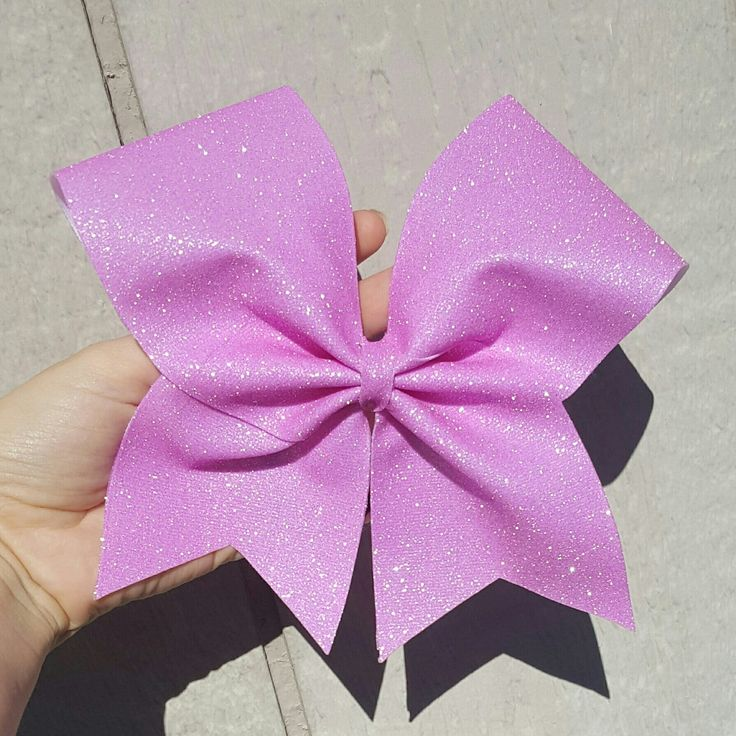 This gorgeous full glitter cheer bow is now available. Many colors available to choose from.