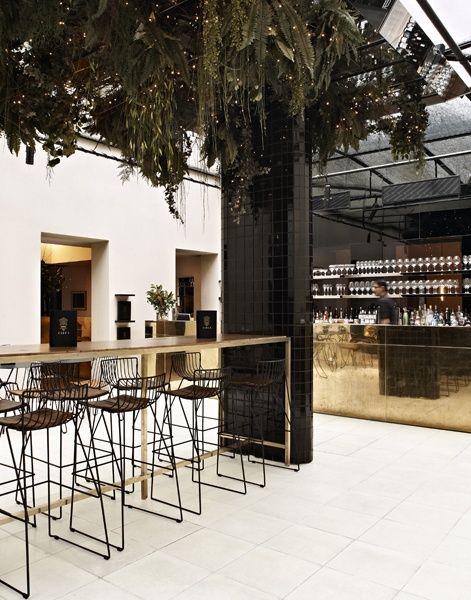 Gold bar, black tiling and hanging garden