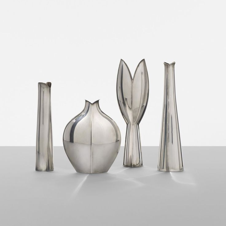 Tapio Wirkkala vases, set of four Suomen Kultaseppien Keskus Oy Finland, 1954 sterling silver 3 w x 2 d x 9.5 h inches Signed with impressed manufacturer's mark to base of each example: [TW] with touchmarks. Signed with impressed manufacturer's mark to base of one example: [AS Oy Vapaudentie 2]. Literature: Tapio Wirkkala: Eye, Hand and Thought, Saarela, ppg. 172, 360