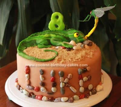 Homemade Lizard Birthday Cake Design: This is a Lizard Birthday Cake Design I made for my son's 8th birthday. He had only two requests, that it be red velvet and a lizard theme. I think I accomplished