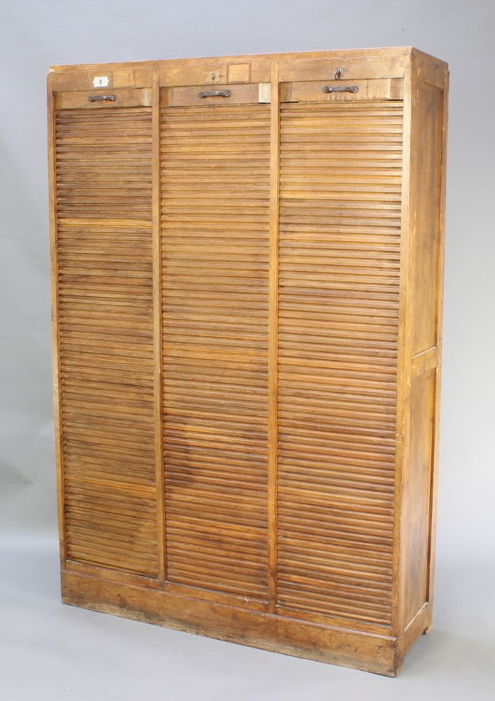 "Lot 939, An Art Nouveau French oak filing cabinet enclosed by tambour shutters, The Meubles Abbey 71""h x 48""w x 14 1/2""d est £80-120"