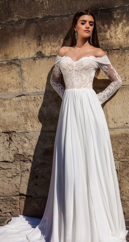 Romantic off-the-shoulder long-sleeve A-line wedding dress; Featured Dress: TM Crystal Design