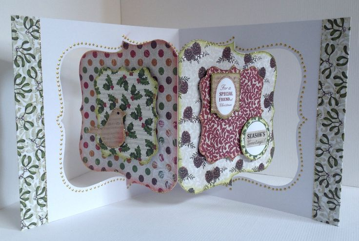 Card designed by Julie Hickey using Mistletoe 6x6 paper pad, die cuts and template. Gorgeous Christmas card in traditional colours with lovely sentiments and robin on a pivot card blank.
