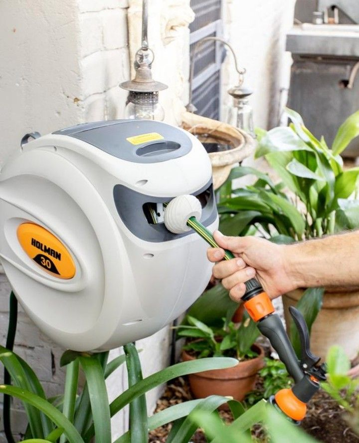Our 30m Retractable Hose Reel Is The Perfect Addition To Your Backyard Create A Neat Storage Solution Versatile Hos Retractable Hose Hose Reel Backyard
