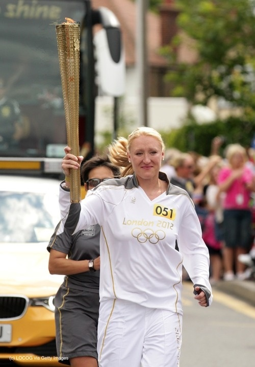Team GB Olympic Tennis Player Torchbearer 051 Elena Baltacha carries the Olympic Flame on the Torch Relay leg between Broadstairs and Cliftonville, on Day 62 of the London 2012 Olympic Torch Relay