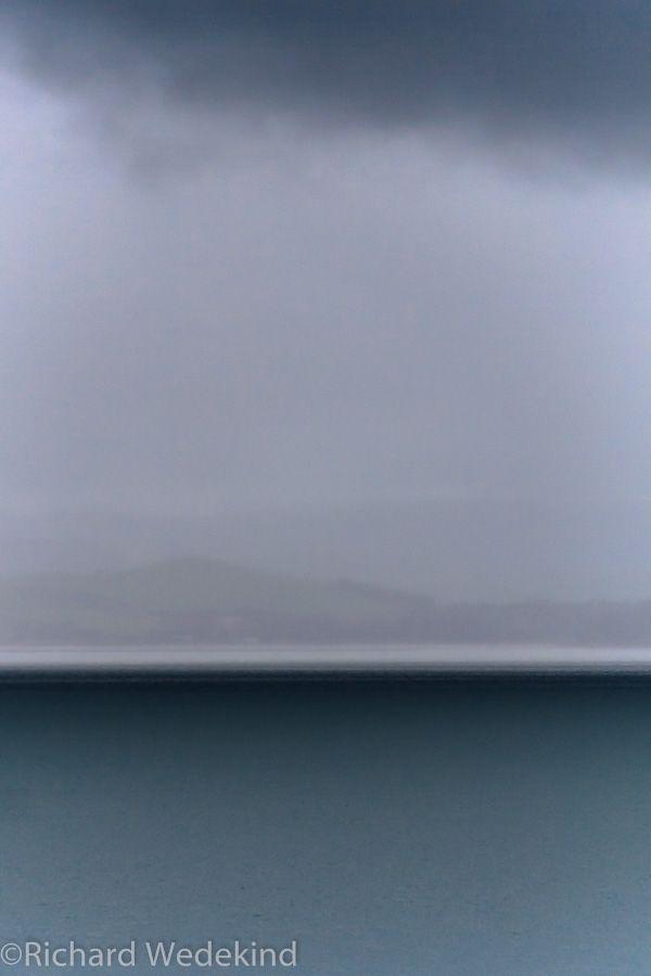 Storm passes between Waiheke and Pakihi islands in the Hauraki Gulf.