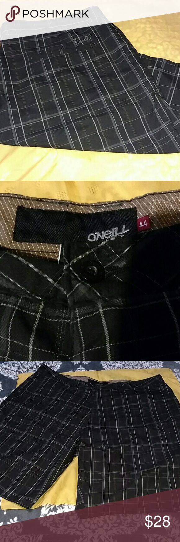 O'Neill shorts Black, with shades of grey plaid print.  O'Neil embroidered on back right pocket.   Hard to find big-n- tall size  LIKE NEW  Spring break!!  Get ready for summer O'Neill Shorts
