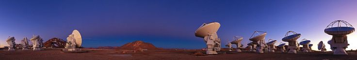 "Thursday, Jan. 16, 2014: The antennas of the Atacama Large Millimeter/submillimeter Array (ALMA) stand under a twilight sky on the Chajnantor Plateau, 16400 feet (5000 meters) above sea level, in Chile. Between the two groups of antennas lie the ""Earth's shadow"" and ""Belt of Venus"" phenomena, visible as the dark blue and light pink bands stretching across the sky. The planet Jupiter hangs above the mountain in the background. (Click image to see full panorama larger.) Image released January…"