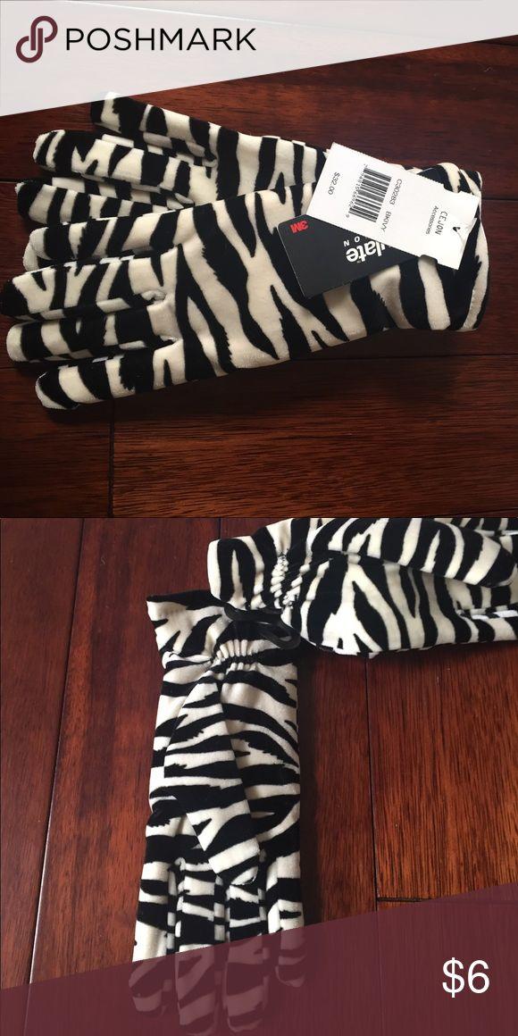 Zebra print thinsulate gloves NWT NWT Thinsulate Zebra gloves. Accessories Gloves & Mittens