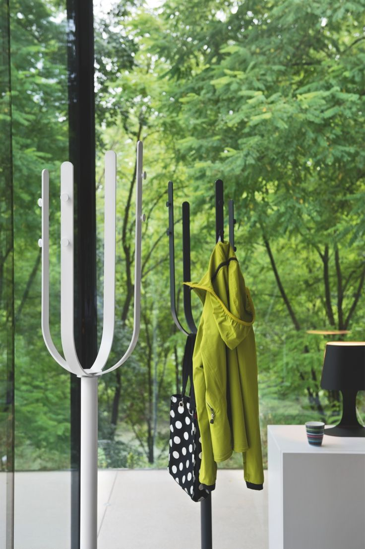 """Thanks to to FLOW's particular design, the stems form a """"basket"""" on the top, thus creating additional storage space for hats, gloves, bags and scarves, leaving the hooks free for coats and jackets. #calligaris #toronto #code"""
