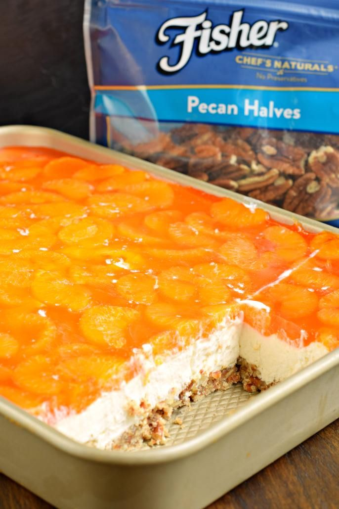 Sweet and salty, this Mandarin Orange Pretzel Bars recipe is the perfect dish to share this summer! You'll love the nutty pecans in the crust of this sweet treat! @fishernuts #thinkfisher #sponsored