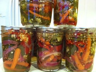 Pickled Jalapenos with a twist - Happy Trails Candy!  1 1/2 lb fresh jalapenos   1 cup sliced carrots (lengthwise or circles)  4 medium red peppers (sweet or hot - not bells - I used Anaheim that had turned from green to red)  1 small onion - halved then sliced  2 cup cider vinegar  4 cups sugar  3 tablespoons mustard seed  2 tablespoon garlic powder