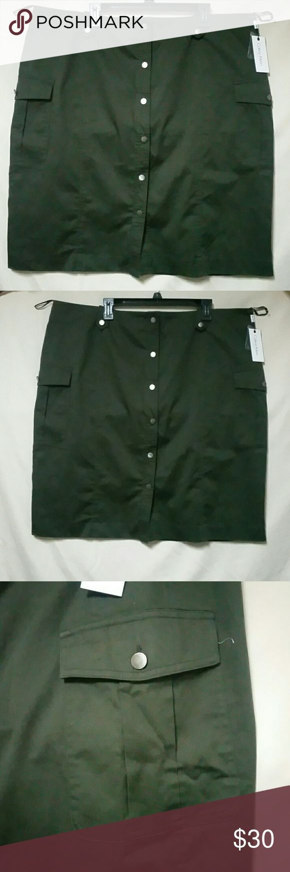 Calvin Klein Military Style Skirt w Cargo Pockets NWT Military Style Skirt w Front Cargo Pockets 6 buttons and mid zipper in Back Olive Green Color (Army Green) waist down measures 25.5 inches Calvin Klein Skirts